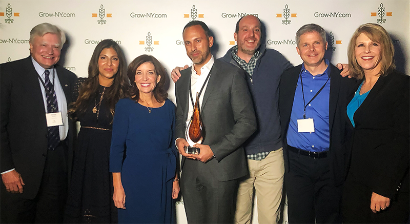 From left to right: Mike Nozzolio, Locate Chairman; Aliya LeeKong, RealEats Culinary Director; Kathy Hochul, New York Lieutenant Governor; Dan Wise, RealEats founder and CEO; Keith Lydon, RealEats VP of Operations; Eric Mozdy, GrowNY mentor to RealEats; Catharine Young, director of the Center of Excellence in Food and Agriculture at Cornell AgriTech.
